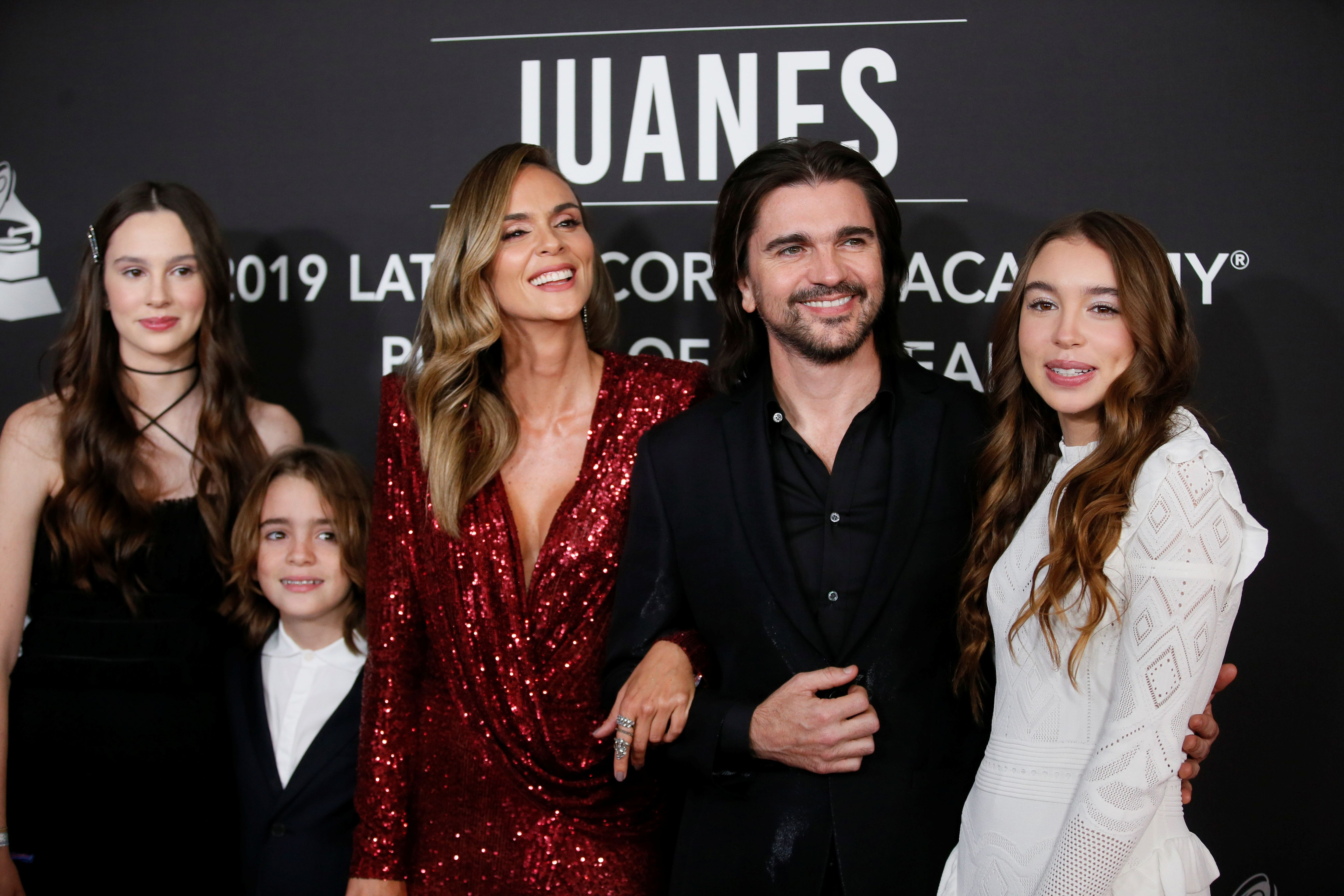 Musician Juanes poses with his family including his wife Karen Martinez, daughters Luna and Paloma and son, Dante at the 2019 Latin Recording Academy Person of the Year gala in his honor in Las Vegas, Nevada, U.S. November 13, 2019. REUTERS/Danny Moloshok